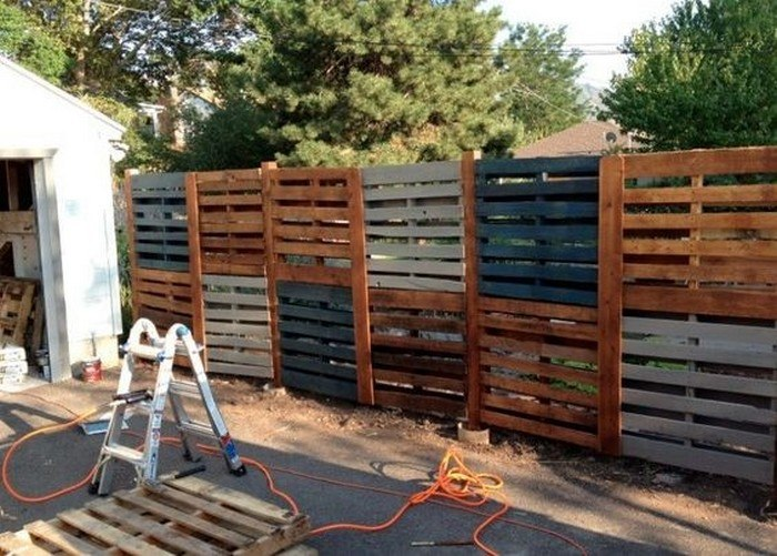 Stack High Wood Pallet Fence Wall