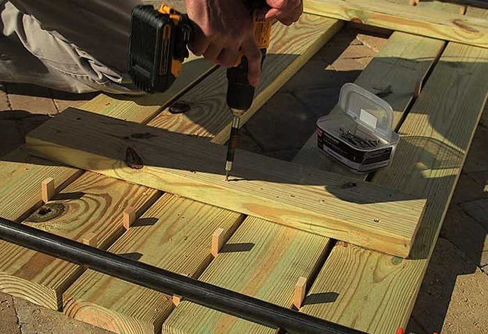 CLAMP THE TABLE SLATS TOGETHER via THE HOME DEPOT