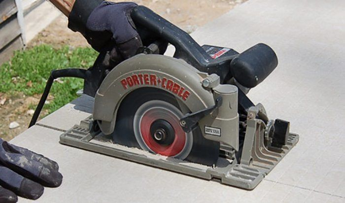 Straight cuts in cement backer board can be made using a circular saw. via Today's Homeowner